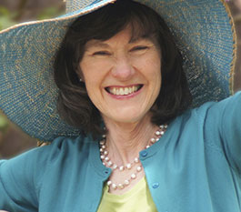 woman with sunhat smiling