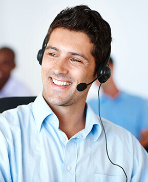 man with headset on smiling