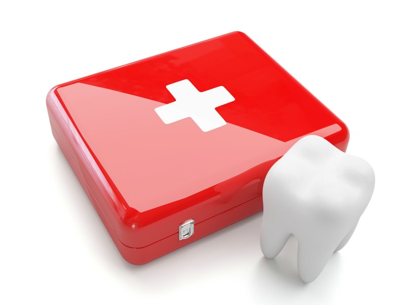 Tooth and medical kit representing an emergency dentist