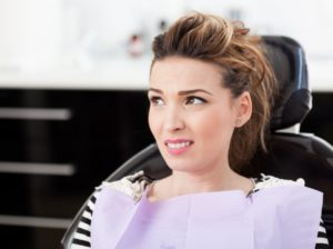 woman learning about smoking and dental implants